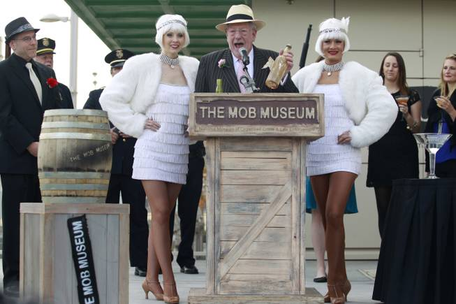 Former Las Vegas Mayor Oscar Goodman holds a bottle of Old Tom Gin during at an event at the Mob Museum Wednesday, Dec. 5, 2012 to publicize a party being held later that evening to mark the end of prohibition. The bottle was found inside the walls when the old federal courthouse was converted into the Mob Museum.