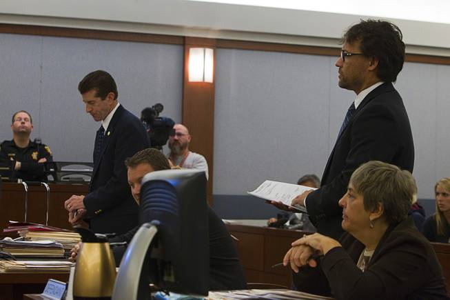 Michael Sanft, standing right, attorney for Dina Palmer, addresses the court at the Regional Justice Center Thursday, December 6, 2012.  Dina Palmer and Markiece Palmer are accused of killing 7-year-old Roderick Arrington.