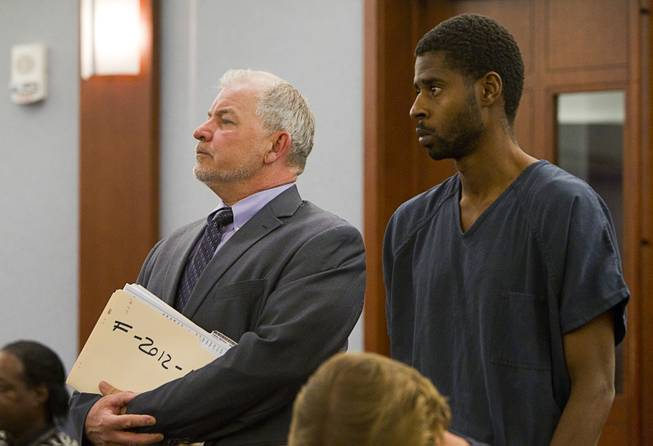 Attorney Tim O'Brien stands by Markiece Palmer during a court appearance at the Regional Justice Center Thursday, December 6, 2012.  Markiece and Dina Palmer are accused of killing 7-year-old Roderick Arrington.