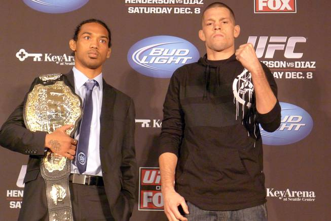 UFC lightweight champion Benson Henderson, left, and challenger Nate Diaz pose on Thursday Dec. 6, 2012 in advance of their main event Saturday on a UFC televised card.