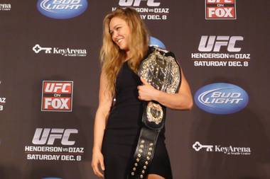 Ronda Rousey shows off her UFC bantamweight championship belt, on Thursday Dec. 6, 2012. UFC president Dana White handed out the belt, saying the former Strikeforce title-holder will make her UFC debut on Feb., 23 against Liz Carmouche.