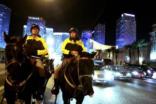 Officers Cody Bunn, left, and Tim Ruiz of Las Vegas Metropolitan Police Mounted Unit patrol the Las Vegas Strip on Friday, December 7, 2012.