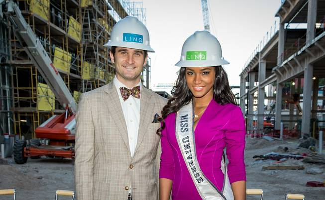 Jon Gray and 2011 Miss Universe Leila Lopes at Linq ...