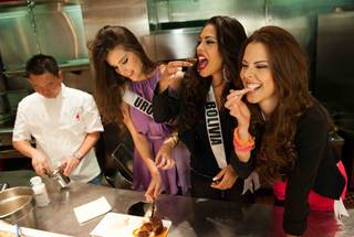 Executive chef Kevin Yee, 2012 Miss Uruguay Camila Vezzoso, 2012 Miss Bolivia Yessica Mouton and 2012 Miss Panama Stephanie Vander Werf at Gordon Ramsay Steak in the Paris on Friday, Dec. 7, 2012.