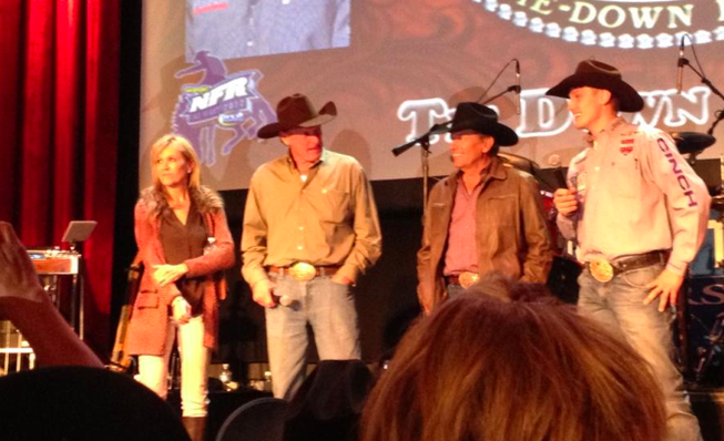 George Strait is brought on stage at the South Point Thursday night following NFR action.