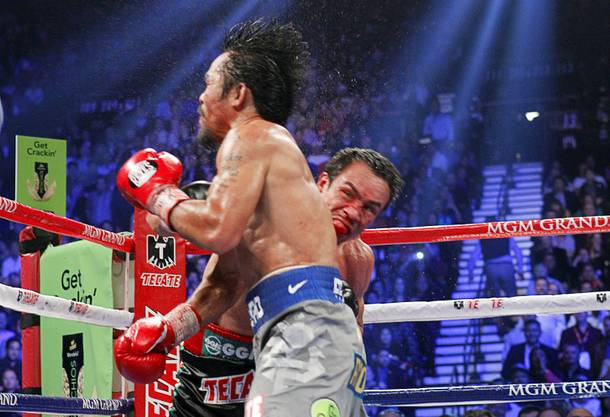 Manny Pacquiao of the Philippines is knocked out by a punch from Juan Manuel Marquez of Mexico during the sixth round of their welterweight fight at the MGM Grand Garden Arena in Las Vegas, Nevada December 8, 2012.