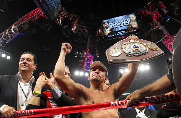Juan Manuel Marquez of Mexico celebrates his 6th round knock out victory over Manny Pacquiao of the Philippines during their welterweight fight at the MGM Grand Garden Arena in Las Vegas, Nevada December 8, 2012. boxing promoter Fernando Beltran is at left.