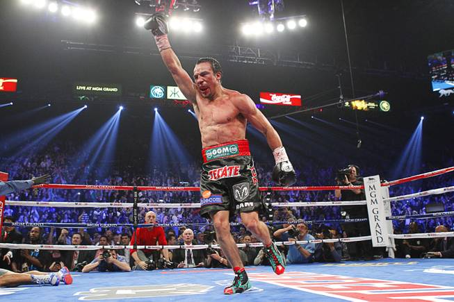 Juan Manuel Marquez of Mexico celebrates his 6th round knock out victory over Manny Pacquiao of the Philippines during their welterweight fight at the MGM Grand Garden Arena in Las Vegas, Nevada December 8, 2012.