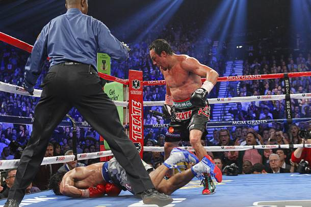 Juan Manuel Marquez (R) of Mexico steps away after knocking out Manny Pacquiao of the Philippines in the 6th round during their welterweight fight at the MGM Grand Garden Arena in Las Vegas, Nevada December 8, 2012.