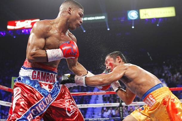 Yuriorkis Gamboa (L) of Cuba punches on Michael Farenas of the Philippines during their WBA interim super featherweight fight at the MGM Grand Garden Arena in Las Vegas, Nevada December 8, 2012.