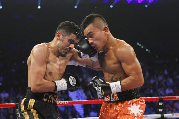 IBF lightweight champion Miguel Angel Vazquez (L) of Mexico exchanges blows against Mercito Gesta of the Philippines during their title bout at the MGM Grand Garden Arena in Las Vegas, Nevada December 8, 2012.