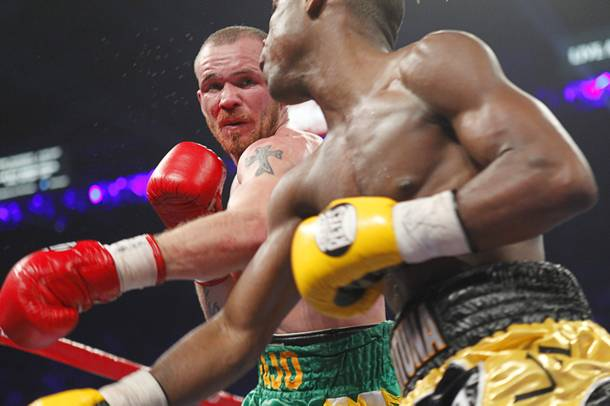 Patrick Hyland (L) of Ireland throws a punch at Javier Fortuna of the Dominican Republic during their WBA interim featherweight fight at the MGM Grand Garden Arena in Las Vegas, Nevada December 8, 2012.
