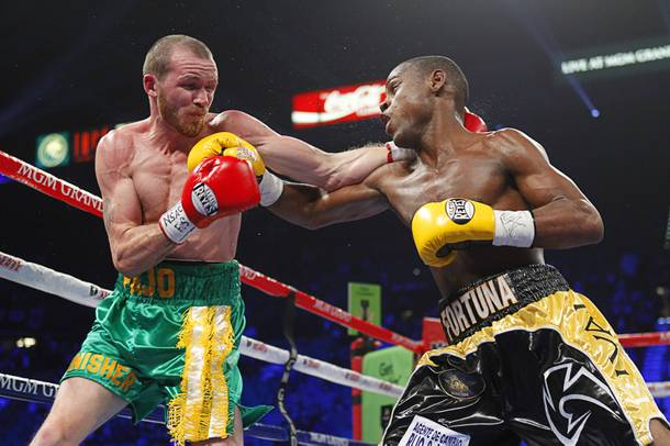 Patrick Hyland (L) of Ireland battles it out with Javier Fortuna of the Dominican Republic during their WBA interim featherweight fight at the MGM Grand Garden Arena in Las Vegas, Nevada December 8, 2012.