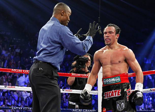 Referee Kenny Bayless gives a count to Juan Manuel Marquez of Mexico after Marquez was knocked down by Manny Pacquiao of the Philippines in the fifth round of their welterweight fight at the MGM Grand Garden Arena in Las Vegas, Nevada December 8, 2012.
