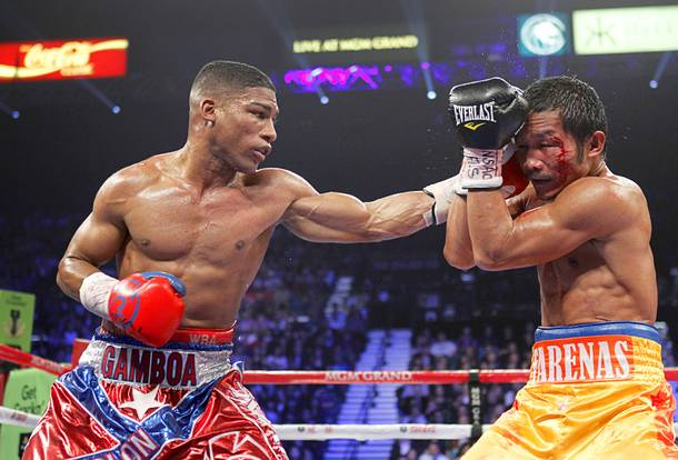 Yuriorkis Gamboa (L) of Cuba connects on Michael Farenas of the Philippines during their WBA interim super featherweight fight at the MGM Grand Garden Arena in Las Vegas, Nevada December 8, 2012.