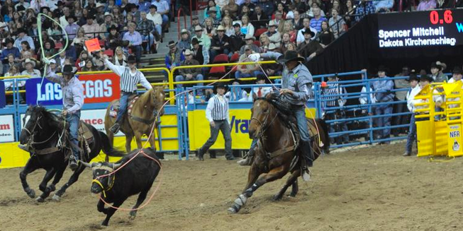 A foul was called on team ropers Spencer Mitchell and Dakota Kirchenschlager as they began their run Friday night during the second go-round at the Wrangler National Finals Rodeo in Las Vegas. The judges did not allow a rerun.
