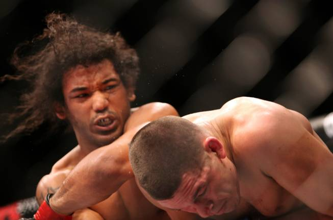 UFC lightweight champion Benson Henderson, left, in action against Nate Diaz during their mixed martial arts bout at a UFC on FOX 5 event in Seattle on Saturday, Dec. 8, 2012. Henderson retained his title via a unanimous five-round decision.