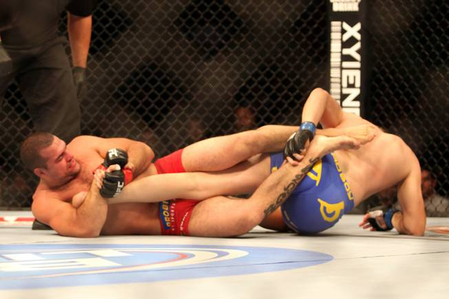 "Alexander Gustafsson, right, defends a leglock against Mauricio ""Shogun"" Rua during their mixed martial arts bout at a UFC on FOX 5 event in Seattle on Saturday, Dec. 8, 2012. Gustaffson won via a unanimous three-round decision."