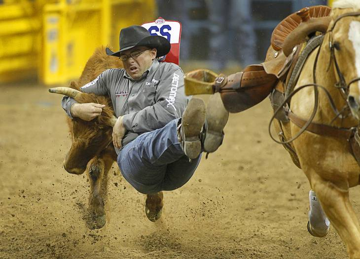 Matt Reeves of Cross Plains. Texas competes in steer wrestling during the fourth go-round of the Wrangler National Finals Rodeo at the Thomas & Mack Center Sunday, Dec. 9, 2012. The NFR continues through Saturday.