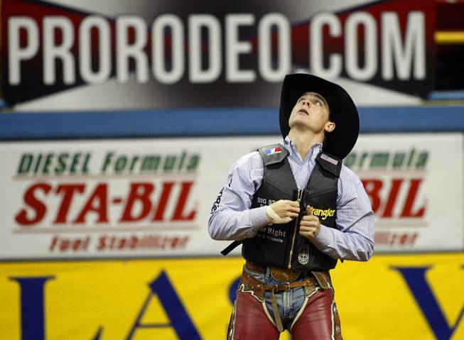 Saddle Bronc rider Jesse Wright of Milford, Utah looks to the scoreboard after riding to a 90 score, the best of the night, during the fourth go-round of the Wrangler National Finals Rodeo at the Thomas & Mack Center Sunday, Dec. 9, 2012. The NFR continues through Saturday.