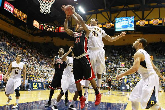 UNLV guard Justin Hawkins drives to the basket while being defended by Cal forward Richard Solomon during the first half of their game Sunday, Dec. 9, 2012 at Haas Pavilion in Berkeley, Calif.