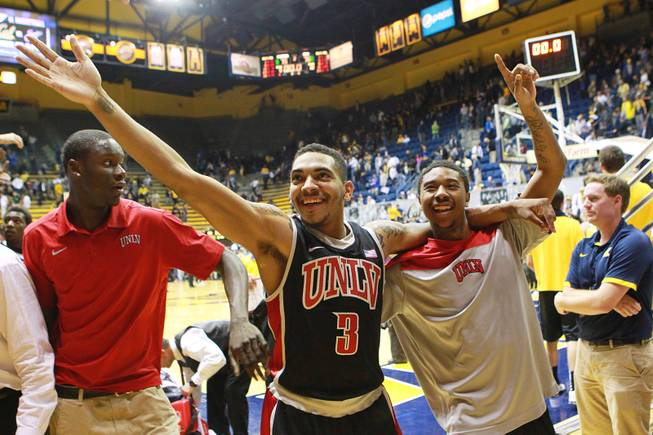 UNLV guards Anthony Marshall and Daquan Cook wave to Rebels fans after their 76-75 win over Cal on Sunday, Dec. 9, 2012, at Haas Pavilion in Berkeley, Calif.