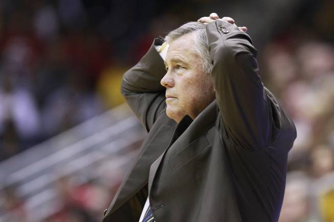 Cal head coach Mike Montgomery puts his hands on his heads after one of his players fouled during the first half of their game against UNLV Sunday, Dec. 9, 2012 at Haas Pavilion in Berkeley, Calif. UNLV won 76-75.