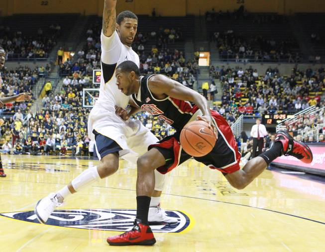 UNLV forward Mike Moser tries to push past Cal forward Richard Solomon during the first half of their game Sunday, Dec. 9, 2012 at Haas Pavilion in Berkeley, Calif. UNLV won 76-75.