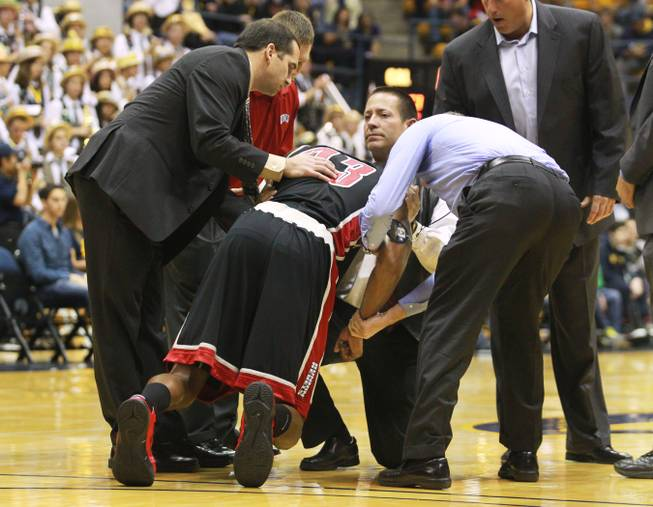 UNLV forward Mike Moser's elbow is stabilized as he is helped up during the first half of their game against Cal Sunday, Dec. 9, 2012 at Haas Pavilion in Berkeley, Calif. UNLV won 76-75. Moser came out of the game with a dislocated elbow.