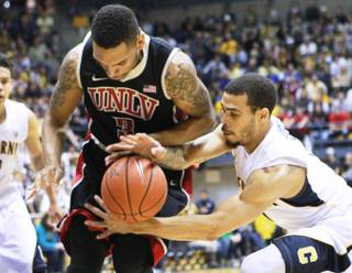 Cal guard Justin Cobbs tries to grab a loose ball from UNLV guard Anthony Marshall during the first half of their game Sunday, Dec. 9, 2012 at Haas Pavilion in Berkeley, Calif. UNLV won 76-75.