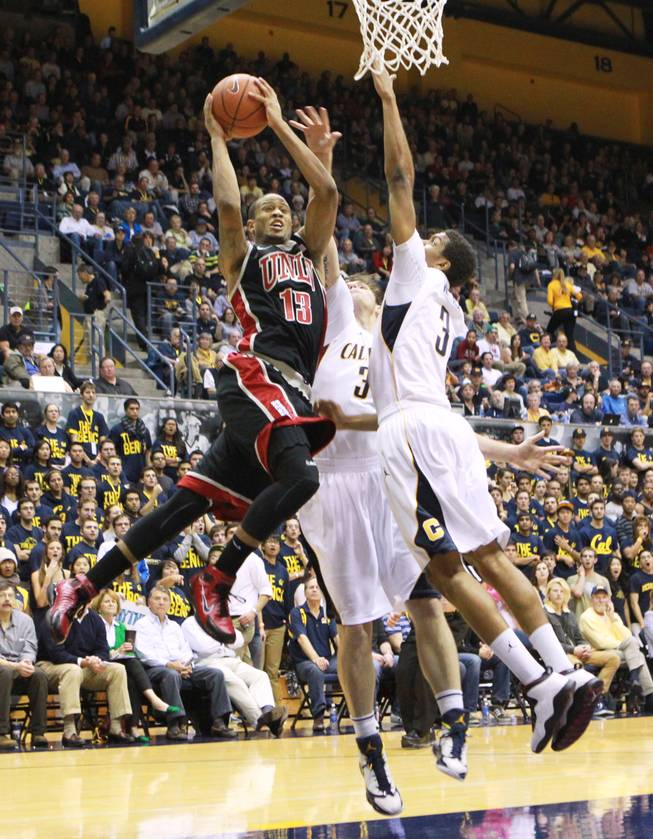 UNLV guard Bryce Dejean-Jones slices to the basket while being defended by Cal forward Robert Thurman and guard Tyrone Wallace, right, during the first half of their game Sunday, Dec. 9, 2012 at Haas Pavilion in Berkeley, Calif. UNLV won 76-75.