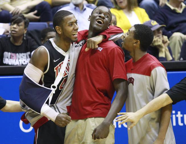 UNLV forward Mike Moser hugs Demetris Morant as they they pull ahead of Cal during the second half of their game Sunday, Dec. 9, 2012 at Haas Pavilion in Berkeley, Calif. UNLV won 76-75.