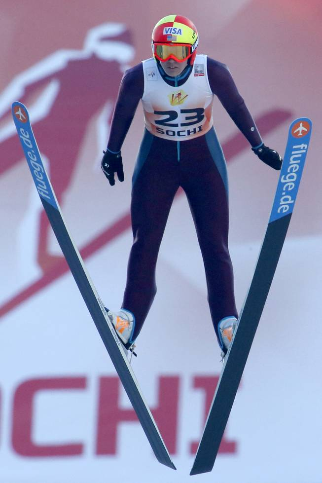 Abby Hughes of the US makes her competition jump during the Women's Normal Hill Individual event at the FIS Ski jumping Cup in Sochi, Russia, Sunday, Dec. 9, 2012.