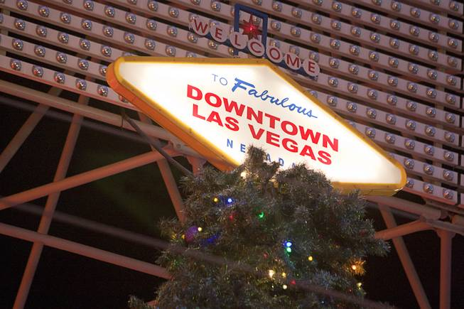 The top of a 55-foot Christmas tree is shown following a tree lighting ceremony at the Fremont Street Experience in downtown Las Vegas Monday, Dec. 10, 2012.