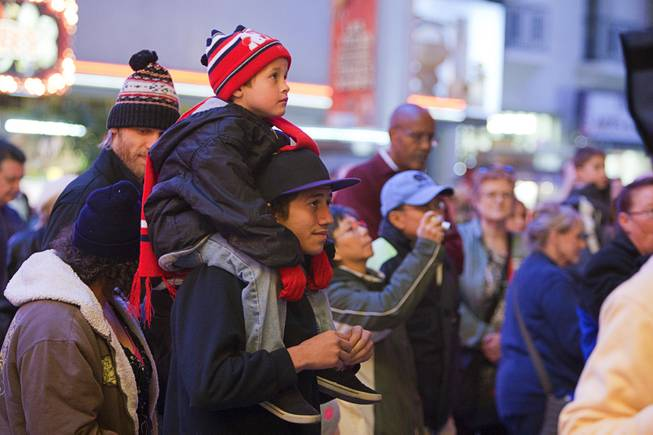 Carter Hansen, 5, and his bother Brodin Carter watch a Christmas tree lighting ceremony at the Fremont Street Experience in downtown Las Vegas Monday, Dec. 10, 2012.