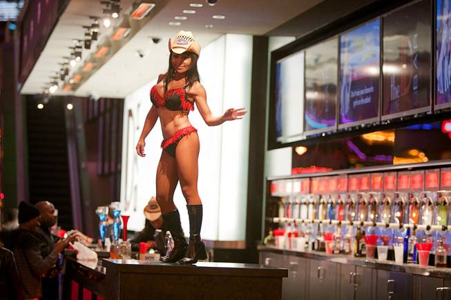 A dancer performs at the D Bar during a Christmas tree lighting ceremony at the Fremont Street Experience in downtown Las Vegas Monday, Dec. 10, 2012.
