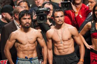 The weigh-in for Manny Pacquiao vs. Juan Manuel Marquez 4 with Pacquiao, Marquez, Mike Tyson, Curtis