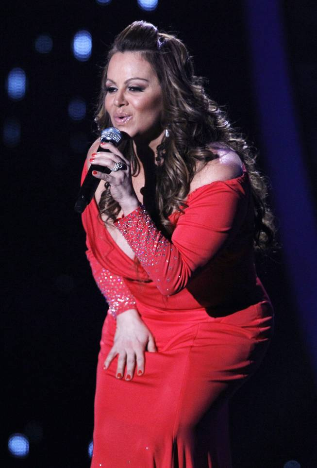 In this April 26, 2012, file photo, singing superstar Jenni Rivera performs during the Latin Billboard Awards in Coral Gables, Fla.