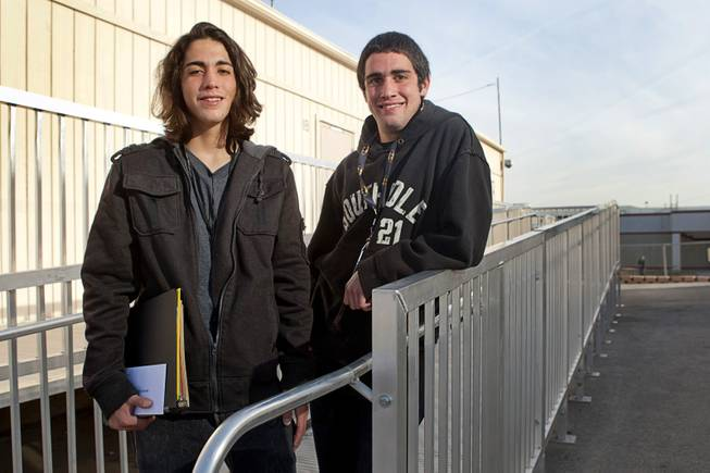 Twins Aalik, left, and Aarik Poeling pose outside a portable classroom at Desert Rose Adult High School in North Las Vegas on Monday, Dec. 11, 2012. Aarik was kicked out of four CCSD schools for fighting, while Aalik dropped out his freshman year and began selling drugs. The brothers, now 18 years old, are trying to get their lives in order and graduate high school.