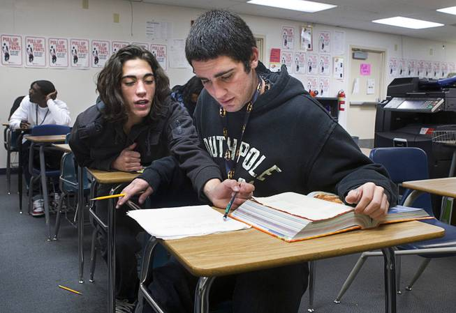 Aalik Poeling, left, comments on his brother's essay during an English class at Desert Rose Adult High School in North Las Vegas on Monday, Dec. 11, 2012. Aarik Poeling was kicked out of four Clark County School District schools for fighting, while Aalik dropped out his freshman year and began selling drugs. The twin brothers, now 18 years old, are trying to get their lives in order and graduate high school.