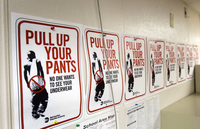Signs discouraging sagging pants are posted in a classroom at Desert Rose Adult High School in North Las Vegas on Monday, Dec. 11, 2012.