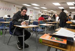 Aarik Poeling reads a Stephen King novel during his English class at Desert Rose Adult High School in North Las Vegas on Monday, Dec. 11, 2012. Aarik was kicked out of four CCSD schools for fighting, while his brother Aalik dropped out his freshman year and began selling drugs. The brothers, now 18 years old, are trying to get their lives in order and graduate high school.