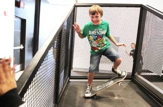 Sheila Tarr Elementary School fifth-grader Donovan Terzian, 10, experiments with balance at the
