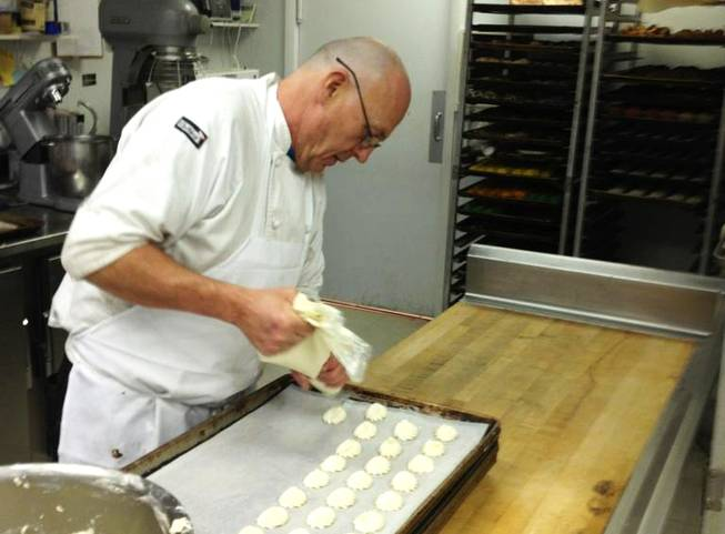 Flemming Pedersen, 57, prepares pastries for a party in his shop located at 7 South Water St. in Henderson. He'll be busy on Wednesday preparing wedding cakes and other confectionery creations for12-12-12.