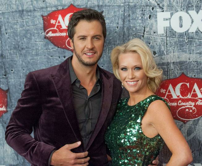 Luke Bryan and his wife Caroline on the red carpet ...