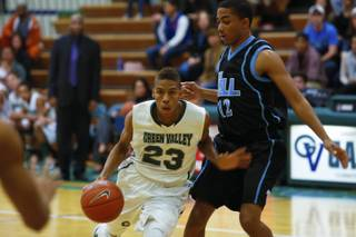 Kenan Haywood, number 23 Green Valley, and Chris Echols, number 12 Foothill High School, during their game, Wednesday, Dec. 12, 2012. Foothill beats Green Valley 68-51.