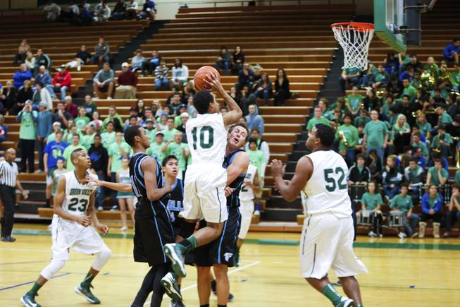 Trey Austin, number 10 Green Valley, attempts to score against Foothill, Wednesday, Dec. 12, 2012. Foothill beats Green Valley 68-51.