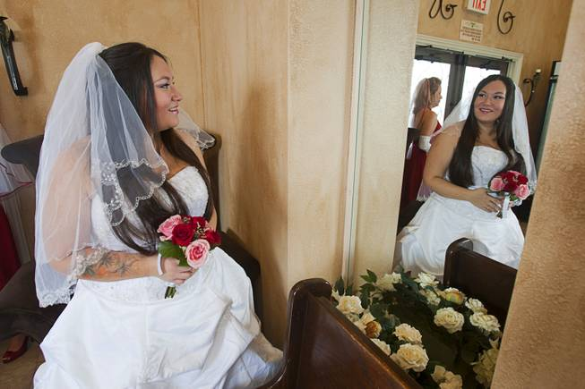 Danielle Martinez looks at her reflection before a group wedding at the Chapel of the Flowers on Las Vegas Boulevard South Wednesday, Dec. 12, 2012. Twelve couples got married at 12:12 pm at the chapel as part of a KOMP 92.3 radio station promotion. Las Vegas wedding chapels were busy all day as many couples wanted to get married on the date of 12-12-12.