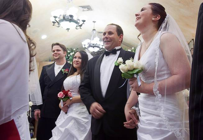 From left, Ryan Maluka, Danielle Martinez, Christopher Shultz and Jessica Cook take part in a group wedding at the Chapel of the Flowers on Las Vegas Boulevard South Wednesday, Dec. 12, 2012. Twelve couples got married at 12:12 pm at the chapel as part of a KOMP 92.3 radio station promotion. Las Vegas wedding chapels were busy all day as many couples wanted to get married on the date of 12-12-12.