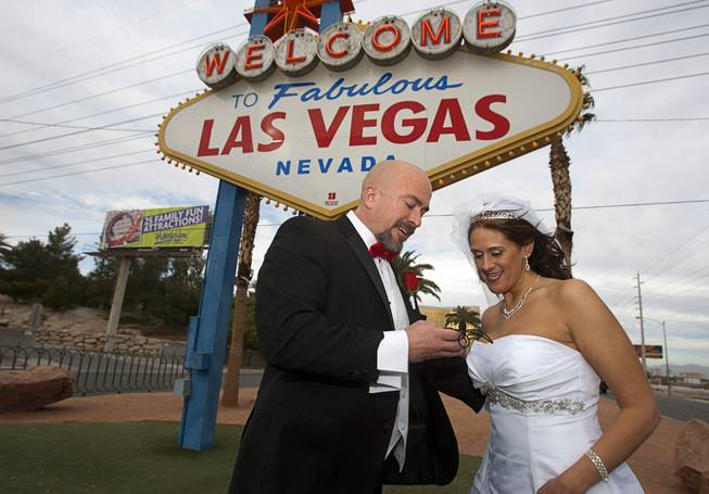 Randy Anderson and Jenni Lafollette of Minneapolis, Minn. look at a photo on their digital camera after getting married Wednesday, Dec. 12, 2012. Las Vegas wedding chapels were busy all day as many couples wanted to get married on the date of 12-12-12.
